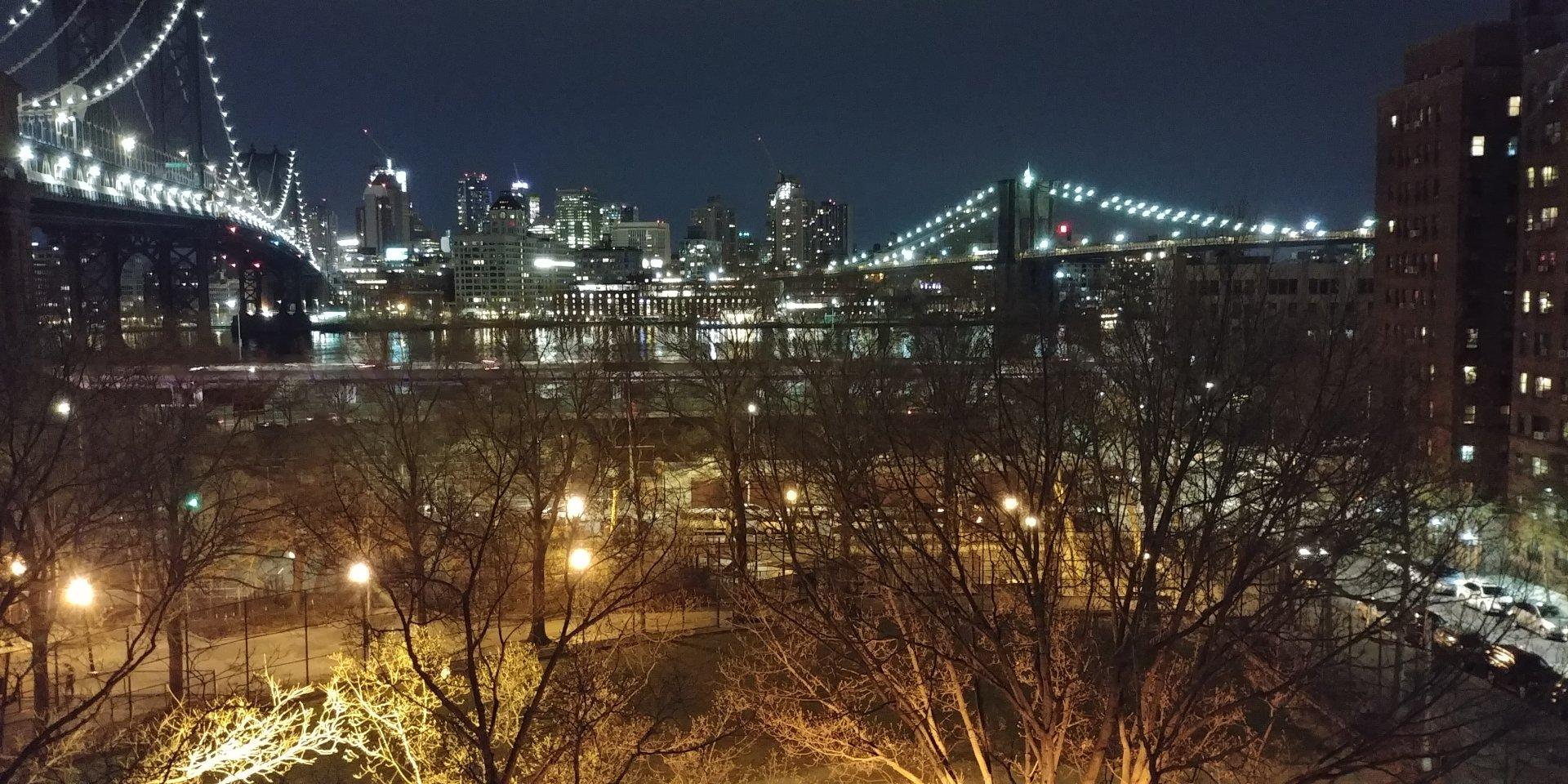View from Chinatown NYC rooftop, of both Brooklyn & Manhattan bridge